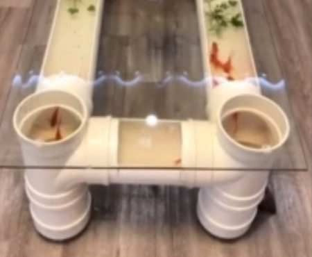 """Virales Video """"Kreativer Mann aus der Provinz Sichuan im süden Chinas baute für 23 amerikanischen Dollar einen Tee-Tisch mit integriertem Aquarium"""""""